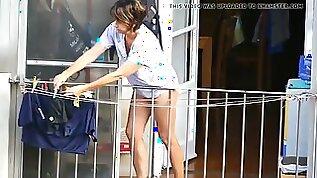 Mature sluty lady in panties on the balcony