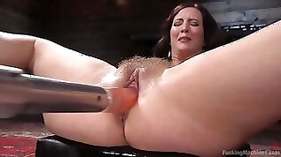 Busty brunette pornstar Cherry Torn gets hairy pussy drilled by machine