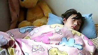 Sleeping Japanese school girl gets hairy twat examined