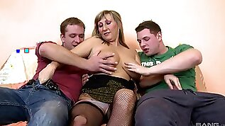 Curvy mature woman is being pumped in both holes by two younger lads