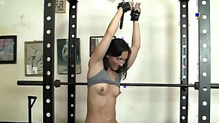Fit Sexy Girl is Chained Up In The Gym
