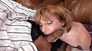Interracial anal side fucking. A milf gets her ass stretched out by a BBC.