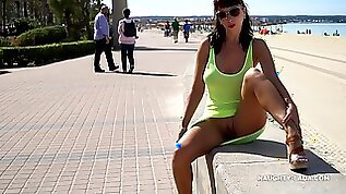 Naughty mom by the sea in see thru Yellow dress flashing shaved cunt