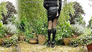 Leather miniskirt black stockings