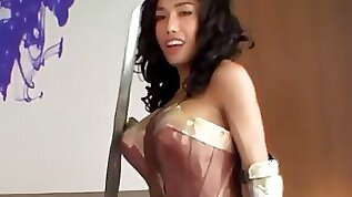Chesty ladyboy in wonder woman uniform fucked bareback