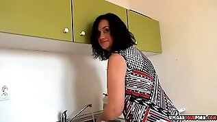 Horny milf shows off her panties while stripping before she masturbates for the camera.