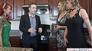 Horny guy is making out with two hot milfs in the middle of a party