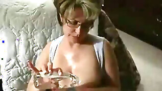Adorable and elegant busty amateur blonde amateur milf loves giving titjob