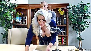 Nerdy blonde in a short skirt rides hard schlong on the table