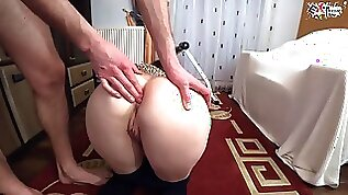 Black Haired is getting fisted from back and groaning because she is about to jizz