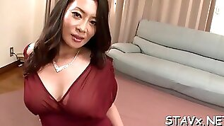 Lusty Asian chick strokes on her hairy beaver naughtily