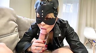 Yasmibutt In The Chain The Leather The Black Mask With Slutty Mouth A Catwoman Sucks Off Her Masters Cock